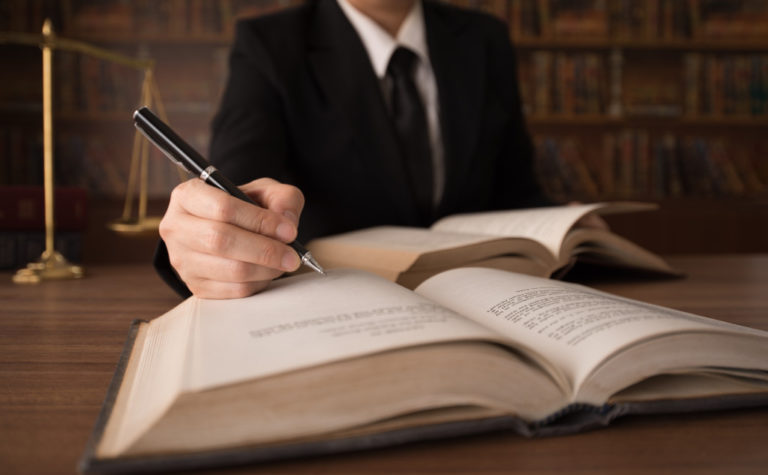 lawyer writing on books